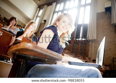 Students in a lecture hall with strong backlighting - stock photo