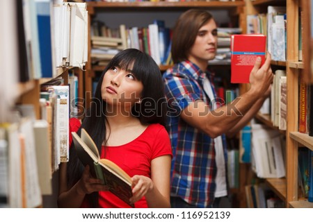 Students in a library choosing a book
