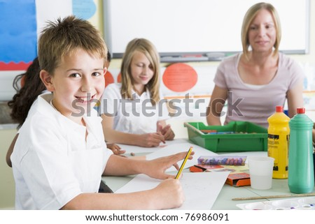 Students in art class with teacher (selective focus) - stock photo