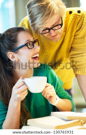 Students in cafe with books - stock photo