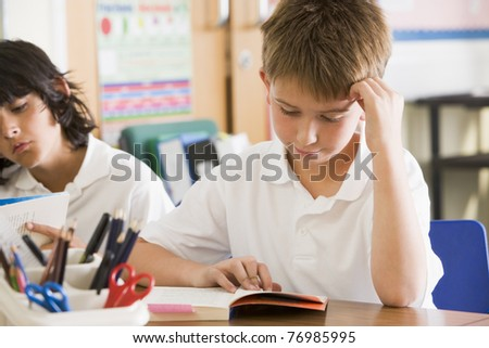 Students in class reading books