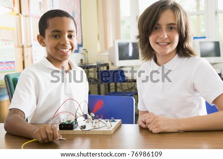 Students in class with electronic project - stock photo