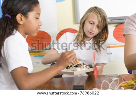 Students in class with electronic projects - stock photo