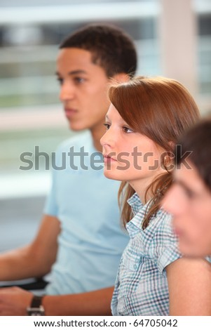 Students in classroom - stock photo