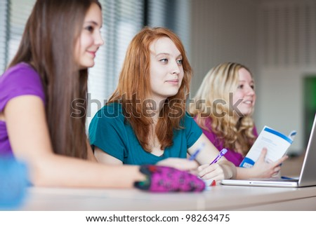 Students in classroom during class (color toned image) - stock photo