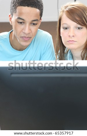 Students in computer classes - stock photo