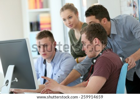 Students in digital design training course with instructor - stock photo