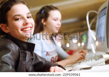 Students in front of computer - stock photo