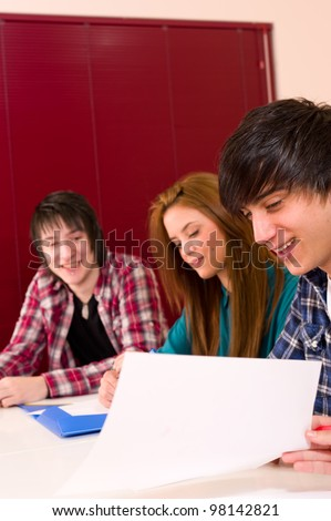 Students inside the classroom at work - stock photo