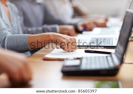 Students knocking on table for approval and applause - stock photo