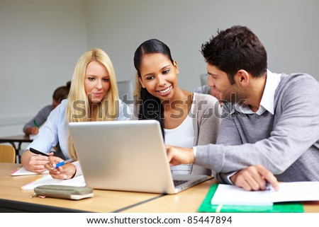 Students learning together in class in universty - stock photo