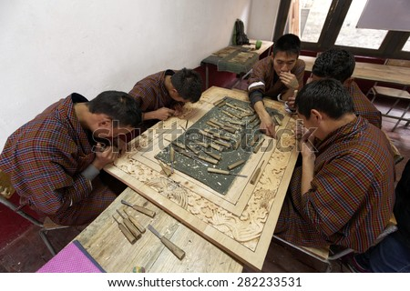 Students learning traditional wood work process at school of arts and crafts, Thimpu, BHUTAN, Circa MAY 2015