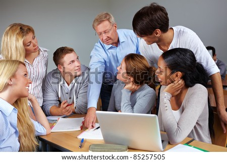 Students learning with teacher in a university - stock photo