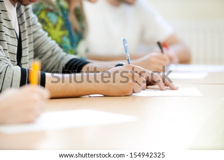students make notes, close up of hands - stock photo