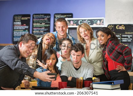 Students making faces for barista taking pictures - stock photo