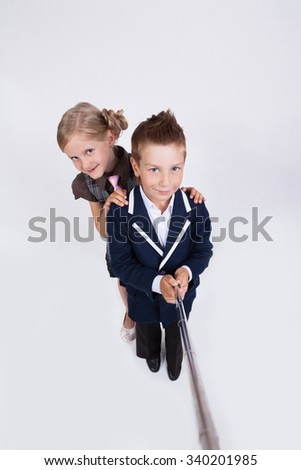 students on a white background photographed himself with a stick for a photo, the photo of the first person. - stock photo