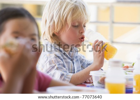 Students outdoors eating lunch (selective focus) - stock photo