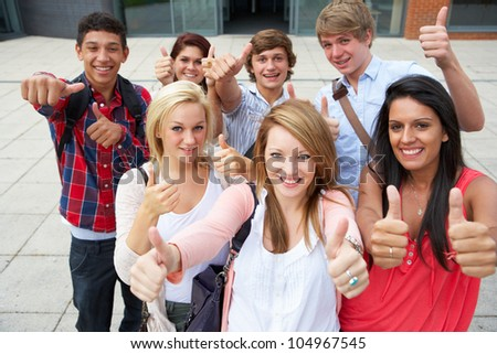 Students outside college - stock photo