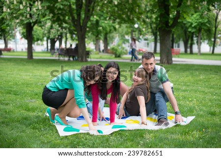 Students play a game in the park twister, beautiful, indoor, little, happy, kindergarten - stock photo