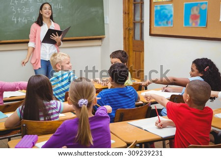Students pointing at fellow classmate at the elementary school
