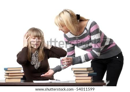 Students prepare for examination on a white background. - stock photo