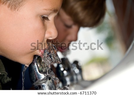 Students quench their thirst during recess at school - stock photo