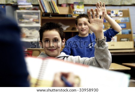 Students raising hands - stock photo