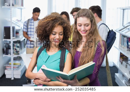 Students reading over their class notes at the college - stock photo