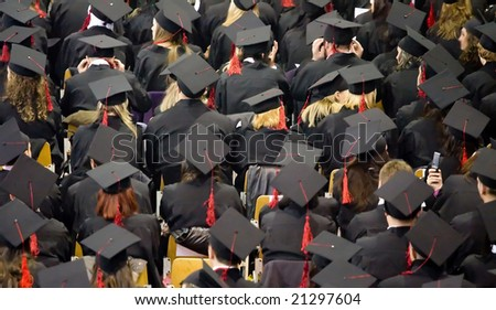 students receiving diplomas - official event - stock photo