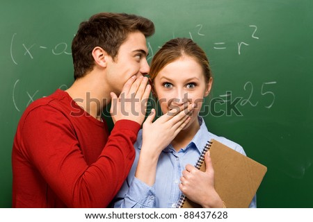 Students sharing secrets - stock photo