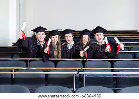 Students sit in a classroom - stock photo