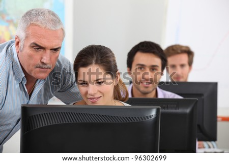 Students sitting at computers - stock photo