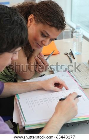 Students sitting in classroom - stock photo