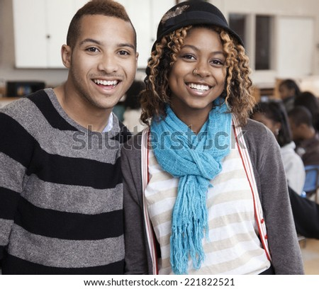 Students smiling in classroom - stock photo