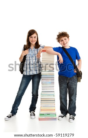 Students standing close to pile of books on white background - stock photo