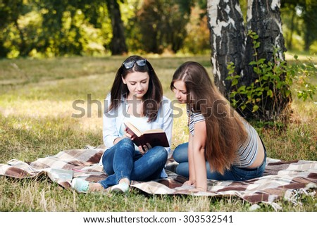 Students studying in a park - stock photo