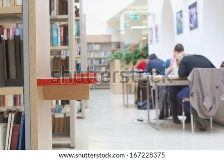 Students studying in a public library at university - stock photo
