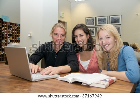 Students studying in study lounge - stock photo