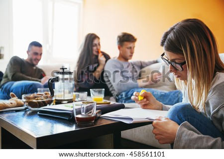 Students Studying In The Living Room - stock photo