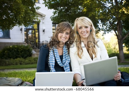 Students Studying on Laptop Computer - stock photo