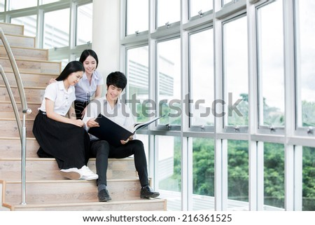 Students studying on steps of knowledge - stock photo