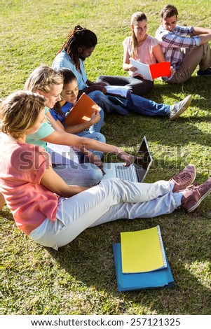 Students studying outside on campus on a sunny day - stock photo