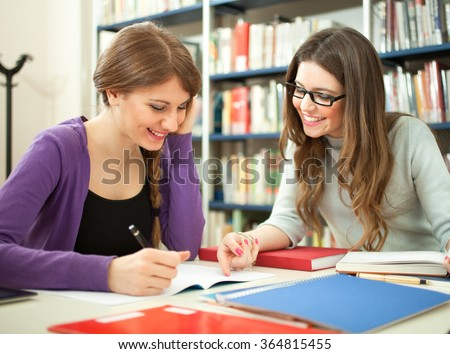 Students studying together in a library