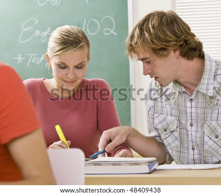 Students studying together in classroom - stock photo