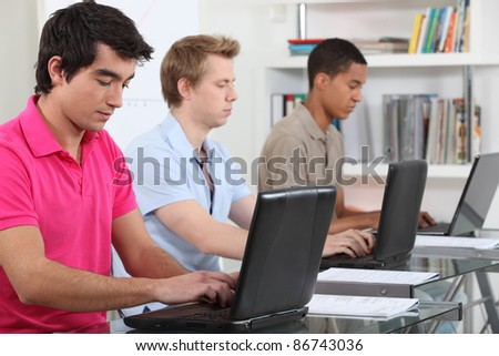 Students using laptop computers - stock photo