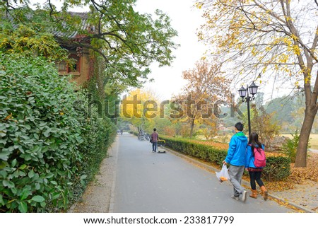 Students walking in campus. Located in Peking University, Beijing, China.