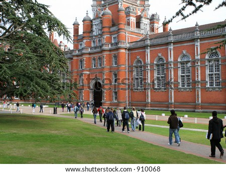 Students walking to red-bricked university building - stock photo