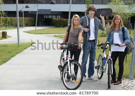 students with bikes and skateboard - stock photo