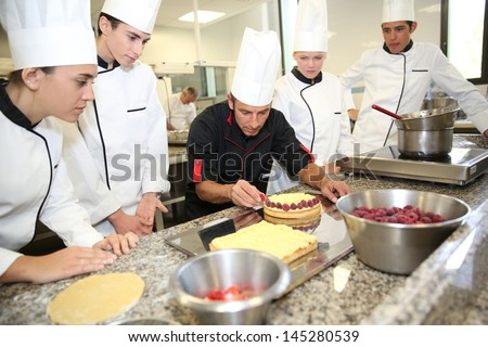 Students with teacher in pastry training course - stock photo