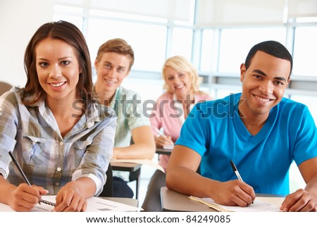 Students working in classroom - stock photo